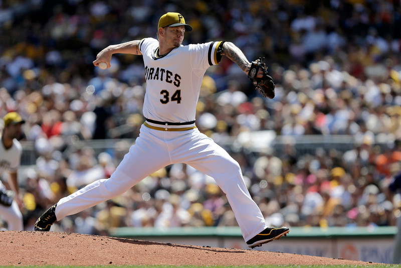 . Pittsburgh Pirates starting pitcher A.J. Burnett (34) delivers during the third inning of a baseball game against the Colorado Rockies in Pittsburgh Sunday, Aug. 4, 2013. (AP Photo/Gene J. Puskar)