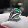1.29ctw Emerald and Diamond Modified Halo Ring 14