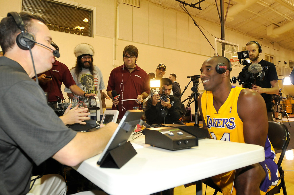 . Kobe Bryant is interviewed by ESPNLA host John Ireland. The Los Angeles Lakers held a media day at their El Segundo practice facility. Players were photographed for team materials, and interviewed by the press. El Segundo, CA. 9/27/2013. photo by (John McCoy/Los An8eles Daily News)
