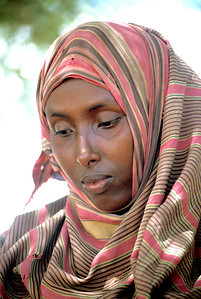 A muslim woman from Somalia in a reflective mood.  Photo by Jim Whitmer