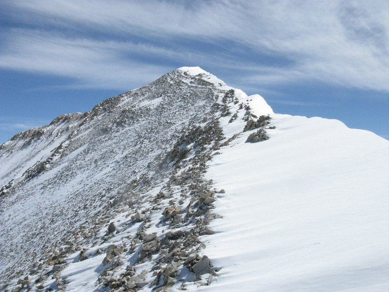 Yep - high winds come from the west and snowload the east slope, possibly creating cornices.