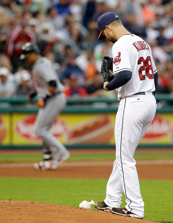 . Cleveland Indians starting pitcher Corey Kluber, right, waits for Detroit Tigers\' Victor Martinez to run the bases after Martinez hit a two-run home run in the fourth inning of a baseball game on Friday, June 20, 2014, in Cleveland. Tigers\' Miguel Cabrera also scored on the hit. (AP Photo/Tony Dejak)