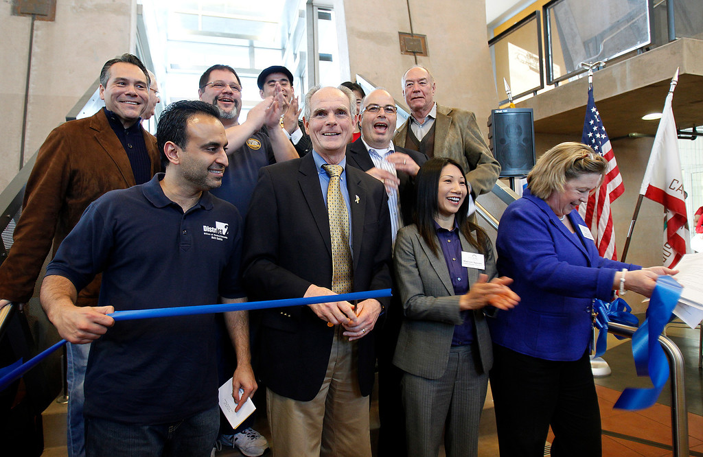 . From foreground right, Interim Library Director Anne Cain, San Jose Vice Mayor Madison Nguyen, San Jose Mayor Chuck Reed, and San Jose City Councilmember Ash Kalra celebrate the ribbon cutting by Reed at  the Seven Trees Branch Library grand opening celebration, in San Jose, Calif. on Saturday, January 26, 2013.   (LiPo Ching/Staff)