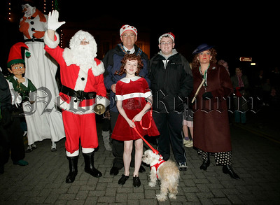 Santa pictured with Mayor Michael Carr, Gary Carroll, Annie,  and Sandy the dog at the switching of the Christmas lights in Newry on Thursday last. 06W48N17