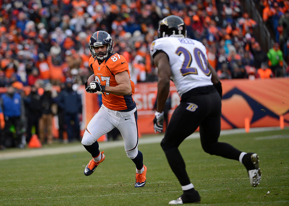 . Denver Broncos wide receiver Eric Decker (87) catches a pass for a gain of 10 yards in the second quarter. The Denver Broncos vs Baltimore Ravens AFC Divisional playoff game at Sports Authority Field Saturday January 12, 2013. (Photo by Joe Amon,/The Denver Post)