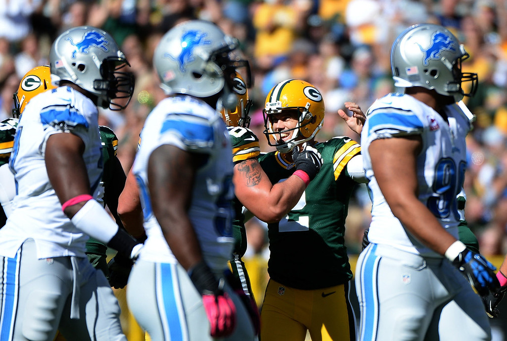 . Mason Crosby #2 of the Green Bay Packers celebrates his second field goal of the game for a 6-0 lead over the Detroit Lions at Lambeau Field on October 6, 2013 in Green Bay, Wisconsin.  (Photo by Harry How/Getty Images)