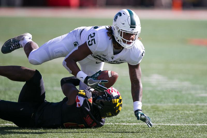 Maryland DB #4 Darnell Savage Jr. tackles Michigan State WR #25 Darrell Stewart Jr.