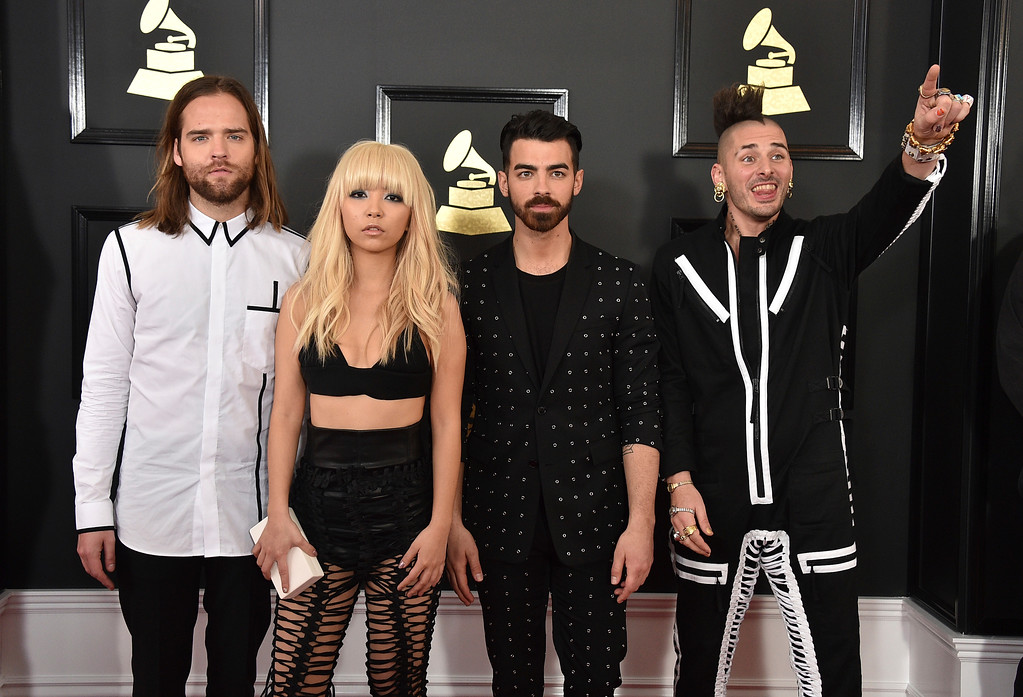 . Jack Lawless, from left, JinJoo Lee, Joe Jonas, Cole Whittle of the musical group DNCE arrive at the 59th annual Grammy Awards at the Staples Center on Sunday, Feb. 12, 2017, in Los Angeles. (Photo by Jordan Strauss/Invision/AP)
