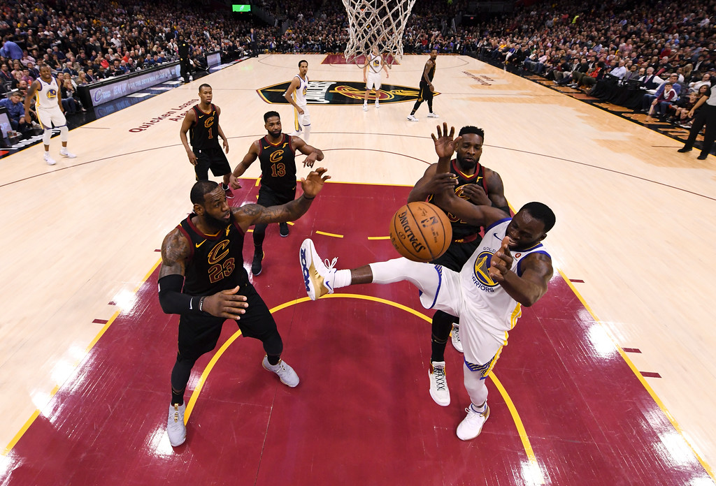 . Golden State Warriors forward Draymond Green (23) looks to regain possession between Cleveland Cavaliers forwards LeBron James (23) and Jeff Green during the second half of Game 3 of basketball\'s NBA Finals, Wednesday, June 6, 2018, in Cleveland. The Warriors defeated the Cavaliers 110-102 to take a 3-0 lead in the series. (Kyle Terada/Pool Photo via AP)
