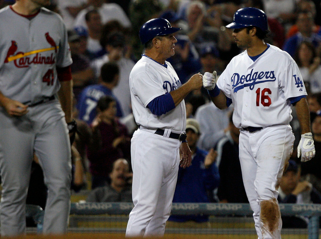 . Los Angeles Dodgers third base coach Larry Bowa bumps fists with Los Angeles Dodgers\' Andre Ethier #16 after Ethier\'s triple in the 5th inning during their game against the St. Louis Cardinals at Dodger StadiumTuesday, August 18, 2009.   (Hans Gutknecht/L.A. Daily News)