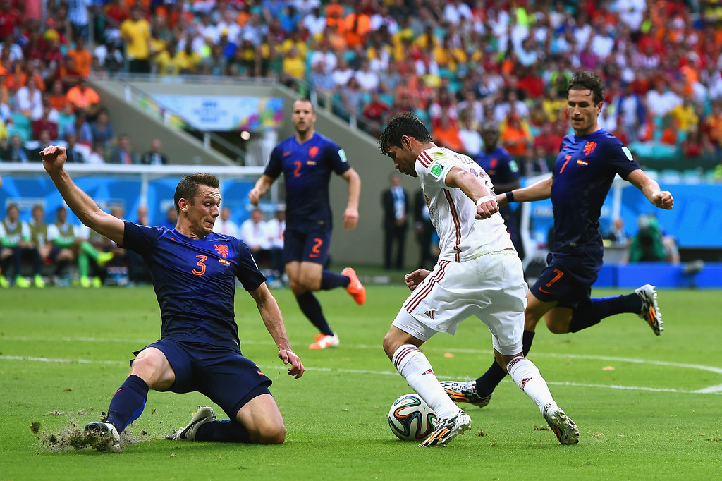 . Stefan de Vrij of the Netherlands moves in to challenge Diego Costa of Spain in the first half during the 2014 FIFA World Cup Brazil Group B match between Spain and Netherlands at Arena Fonte Nova on June 13, 2014 in Salvador, Brazil.  (Photo by David Ramos/Getty Images)