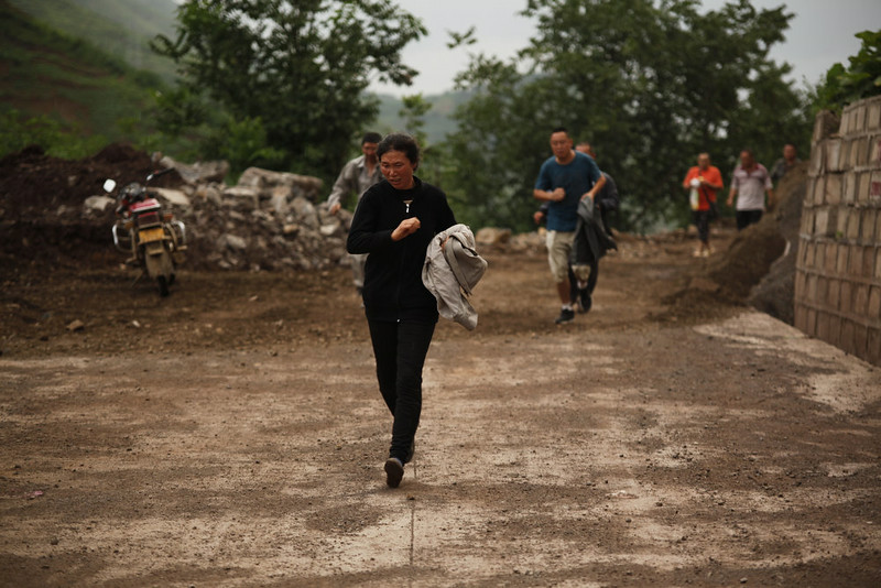 . Local people evacuate the area after a 6.5-magnitude earthquake on August 3, 2014 in Zhaotong, Yunnan province of China. A 6.5-magnitude earthquake hit Zhaotong\'s Ludian county at a depth of 12 kilometers. The quake struck Longtoushan Township at 4:30 pm, Beijing time on Sunday, about 50 kilometers from the city center of Zhaotong. (Photo by ChinaFotoPress/Getty Images)