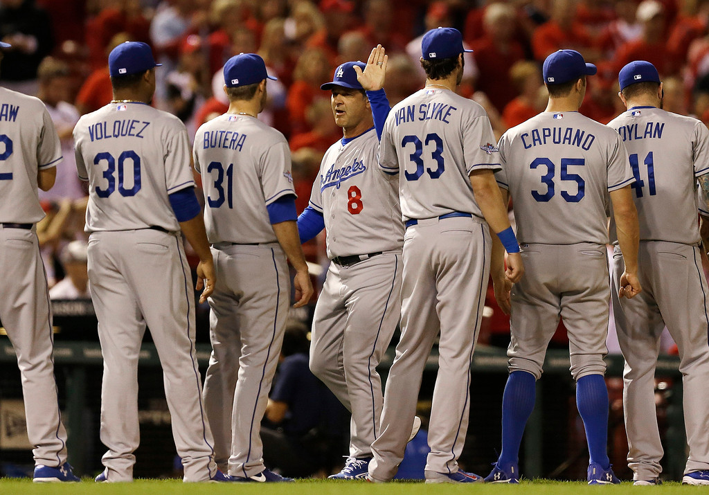 . Los Angeles Dodgers manager Don Mattingly is introduced before Game 1 of the National League baseball championship series against the St. Louis Cardinals Friday, Oct. 11, 2013, in St. Louis. (AP Photo/Jeff Roberson)