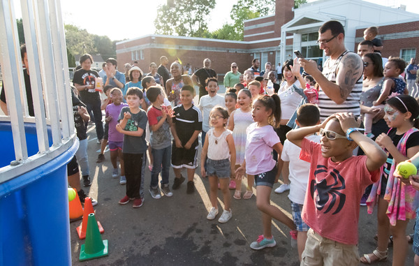 06/08/18 Wesley Bunnell | Staff Vance Elementary School held an end of the year celebration on Friday night for students and parents. Spectators laugh as Jeff Petillo falls into the dunk tank.