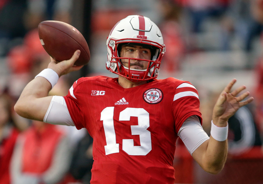 . Nebraska quarterback Tanner Lee (13) warms up before an NCAA college football game against Ohio State in Lincoln, Neb., Saturday, Oct. 14, 2017. (AP Photo/Nati Harnik)