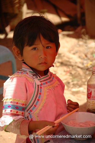 Hani Girl Eating Soup - Yuanyang, China