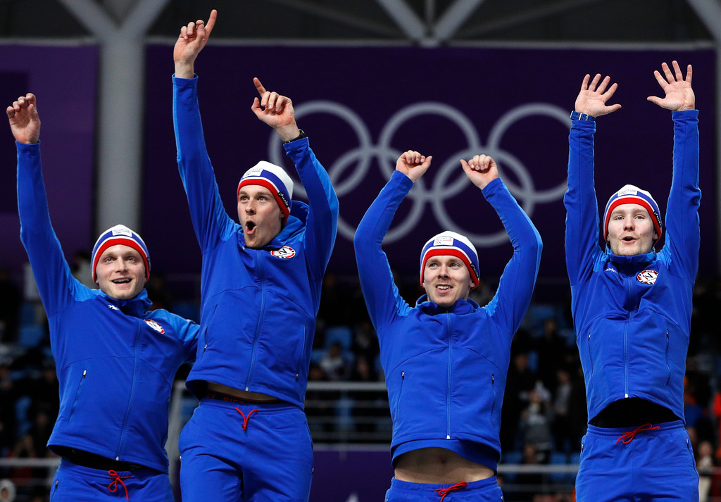 . Gold medalist team Norway celebrates on the podium after the men\'s team pursuit final speedskating race at the Gangneung Oval at the 2018 Winter Olympics in Gangneung, South Korea, Wednesday, Feb. 21, 2018. (AP Photo/John Locher)