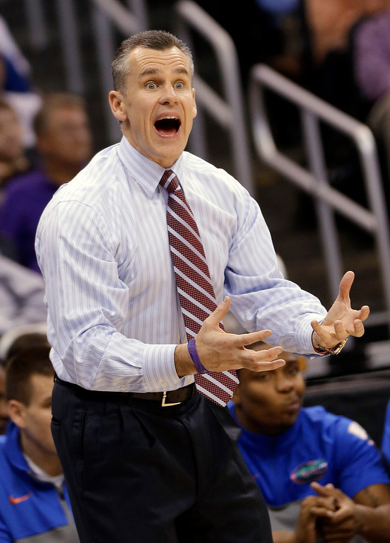 . Florida coach Billy Donavan gestures to his team during the second half in a second-round game against Albany in the NCAA men\'s college basketball tournament Thursday, March 20, 2014, in Orlando, Fla. (AP Photo/John Raoux)
