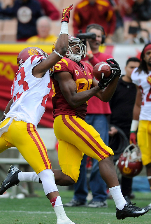 . WR Victor Blackwell catches a pass behind CB Kevon Seymour at USC\'s Spring Football Game. (Michael Owen Baker/Staff Photographer)