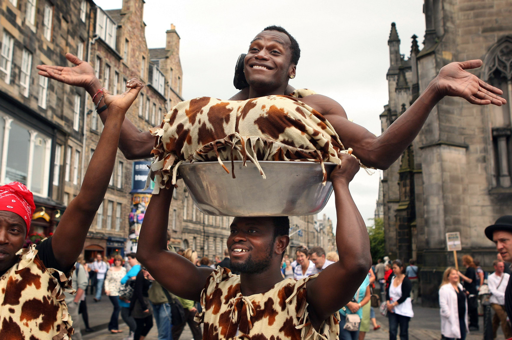 . The Fanti Acrobats International perform on the Royal Mile, Edinburgh, Scotland as part of the Fringe Festival Friday Aug. 20, 2010.   (AP Photo/David Cheskin/PA Wire)  ** UNITED KINGDOM OUT NO SALES NO ARCHIVE **