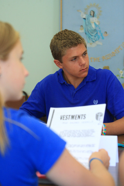 Alec Giakas and the 8th grade class learn about vestments during summer religious education class prep at St. Mary of the Assumption, Wednesday, August 15, 2012. photo/www.DonBlakePhotography.com