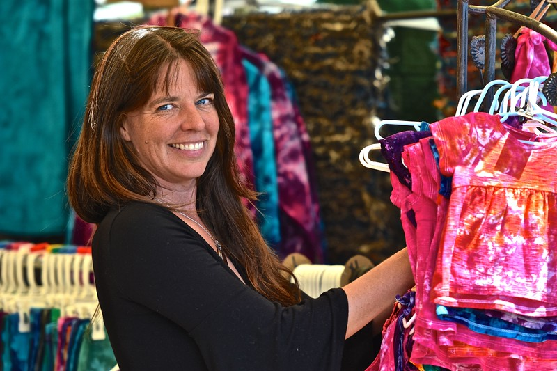 Amy Pollack gives the camera a smile as she makes another sale at her tie-dye business booth at the festival. José Quezada—For the Times-Standard
