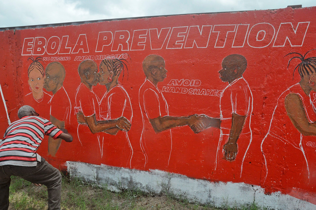 . A local Liberian artist paints a mural forming part of the countrys fight against the deadly Ebola virus by education in the city of Monrovia, Liberia, Tuesday, Sept. 23, 2014. U.S. health officials Tuesday presented worst-case and best-case scenarios for the Ebola epidemic in West Africa, calculating that as many as 1.4 million people could be sickened in two countries alone by mid-January _ or the outbreak could be winding down by then, if control efforts substantially increase. (AP Photo/Abbas Dulleh)