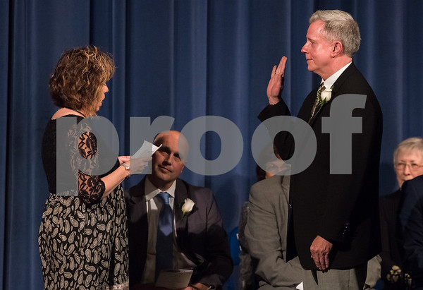 11/13/17 Wesley Bunnell | Staff The City of Bristol held their 2017 Inaugural on Monday evening at Bristol Eastern High School. Peter Kelley for City Council District 2 with the oath administered by Sheila Kelley.