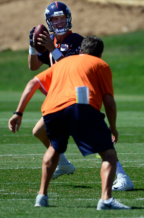 . CENTENNIAL, CO - AUGUST 19: Quarterback Peyton Manning runs through drills during practice on Tuesday, Aug. 29. 2014. The Denver Broncos prepare at Dove Valley on Tuesday, Aug. 19, 2014 in Centennial for their upcoming game against the Houston Texans on Saturday, Aug. 23, 2014. (Photo by Kathryn Scott Osler/The Denver Post)