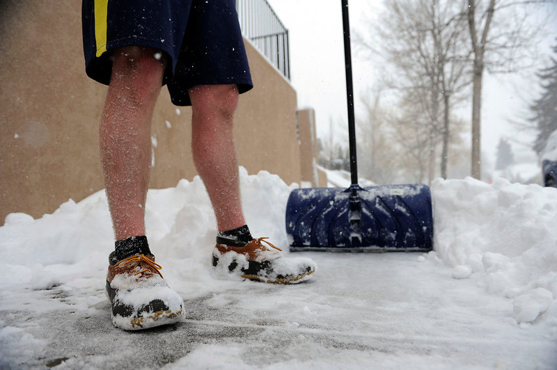 ". Ben Verlander shovels snow from the sidewalk in front of his home on Ogden St in Denver on Sunday, February, 24, 2013. ""It\'s really not that cold out.\"" Verlander said of his decision to wear shorts while shoveling. Seth A. McConnell, The Denver Post"