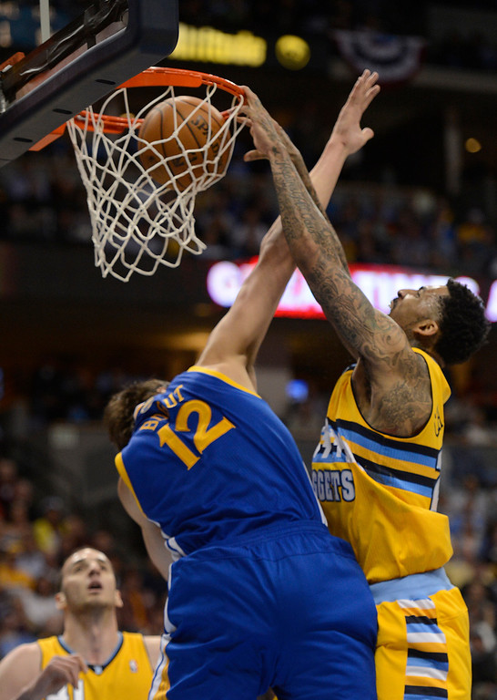 . DENVER, CO. - APRIL 23: Denver Nuggets shooting guard Wilson Chandler (21) dunks the ball over Golden State Warriors center Andrew Bogut (12) in the first quarter. The Denver Nuggets took on the Golden State Warriors in Game 2 of the Western Conference First Round Series at the Pepsi Center in Denver, Colo. on April 23, 2013. (Photo by John Leyba/The Denver Post)