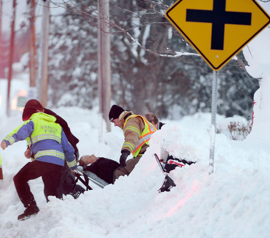 . Emergency crews in Elma respond to a first aid call as they navigate their way through the snow on Bowen Rd. in Elma, N.Y. Friday, Nov. 21, 2014. Rescue efforts have been hampered as a result of the epic snowfall. (AP Photo/Gary Wiepert)