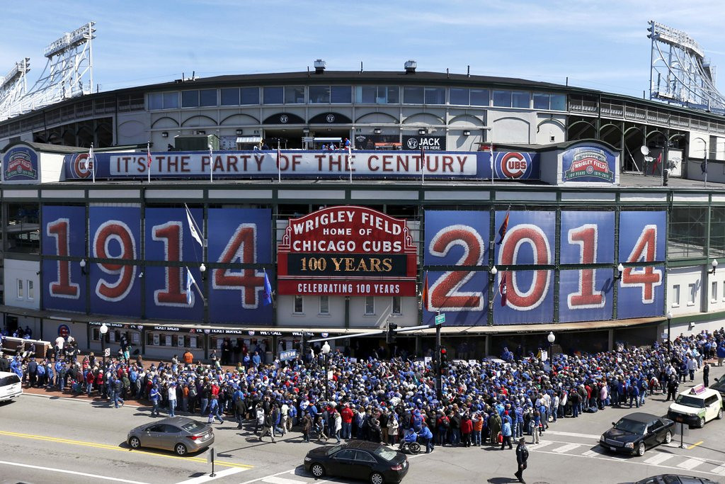 """. <p><b> Chicago Cubs fans turned out at the Friendly Confines last week to help celebrate the 100th anniversary of � </b> <p> A. The first game at Wrigley Field <p> B. The Cubs franchise <p> C. The Cubs� last winning season <p><b><a href=\'http://www.twincities.com/sports/ci_25620184/scorekeeper-at-wrigley-practices-dying-art\' target=\""""_blank\""""> LINK </a></b> <p>   (AP Photo/Charles Rex Arbogast)"""
