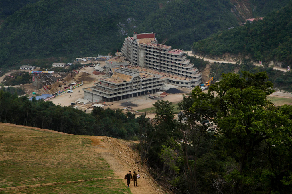 ". An unfinished hotel complex stands at the bottom of a mountain slope at the ski resort construction project at North Korea\'s Masik Pass. This is the Masik Pass ski resort, North Korea\'s latest megaproject, the product of 10 months of furious labor intended to show the world that this country, so often derided for its poverty and isolation, is as civilized and culturally advanced as any other. North Korean authorities have been encouraging a broader interest in sports in the country, calling it ""the hot wind of sports blowing through Korea.\"" (AP Photo/David Guttenfelder)"
