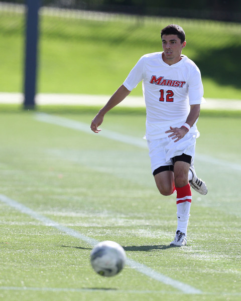 POUGHKEEPSIE, NY - SEPTEMBER 23: Anthony Rozmus #12 readys to pass ball during Yale verses Marist Soccer on September 23, 2012 at Tenney Stadium in Poughkeepsie New York.  Yale defeats Marist 2-1. (Photo by Sandy Tambone)