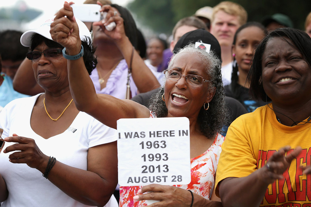 """. Betty Waller Gray (C) of Richmond, Virginia, cheers during the \'Let Freedom Ring Commemoration and Call to Action\' honoring the 50th anniversary of the historic March on Washington for Jobs and Freedom on the National Mall August 28, 2013 in Washington, DC. The 1963 landmark civil rights event was where Dr. Martin Luther King Jr. delivered his famous speech, saying, \'I still have a dream, a dream deeply rooted in the American dream...one day this nation will rise up and live up to its creed, \""""We hold these truths to be self evident: that all men are created equal.\"""" I have a dream . . .\'  (Photo by Chip Somodevilla/Getty Images)"""