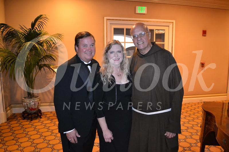 Bob and Beth Huston with Father Tony Marti