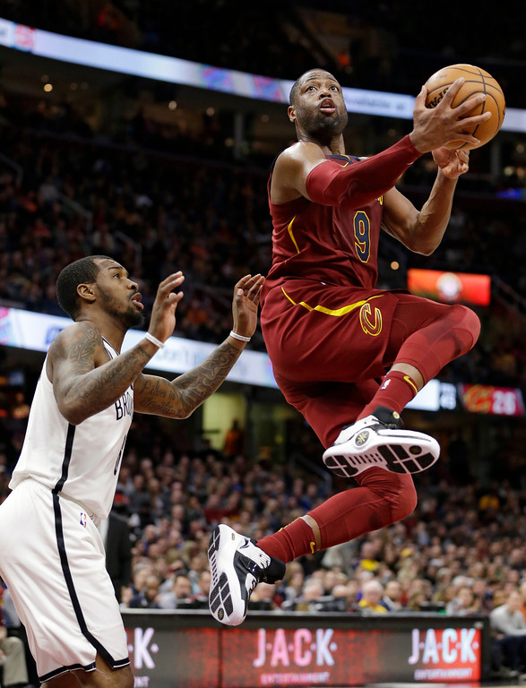 . Cleveland Cavaliers\' Dwyane Wade, right, drives to the basket against Brooklyn Nets\' Sean Kilpatrick during the second half of an NBA basketball game, Wednesday, Nov. 22, 2017, in Cleveland. The Cavaliers won 119-109. (AP Photo/Tony Dejak)