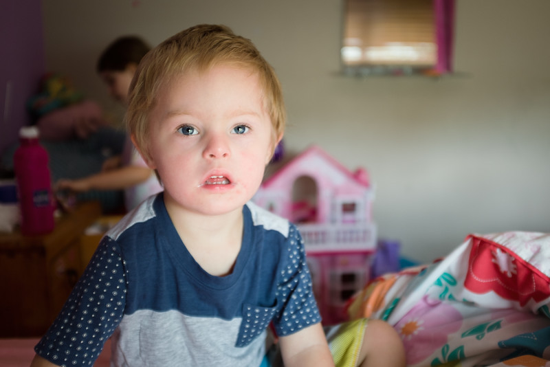 Little Boy with Blonde Hair at Home