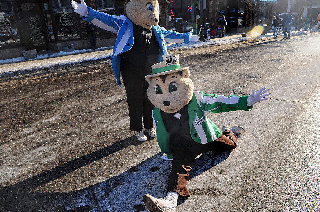 . Gopher mascots from the Minnesota State Fair dance around at the Winter Carnival Grande Day Parade in St. Paul, Saturday January 25, 2014. (Pioneer Press: Jean Pieri)