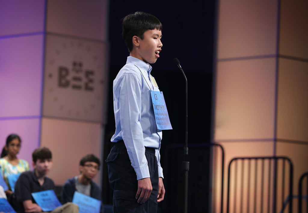 . Speller Timothy Lau of Torrance, California, reacts after he correctly spelled his word during round five of the 2014 Scripps National Spelling Bee competition May 29, 2014 in National Harbor, Maryland. Forty-six spellers have advanced to the semifinals to compete for the top honor in the annual spelling contest.   (Photo by Alex Wong/Getty Images)