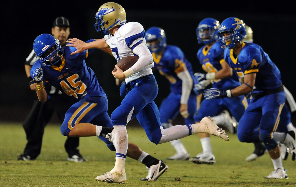 . Santa Margarita quarterback KJ Costello runs for a first down against Bishop Amat in the first half of a prep football game at Bishop Amat High School on Friday, Aug. 30, 2013 in La Puente, Calif.   (Keith Birmingham/Pasadena Star-News)