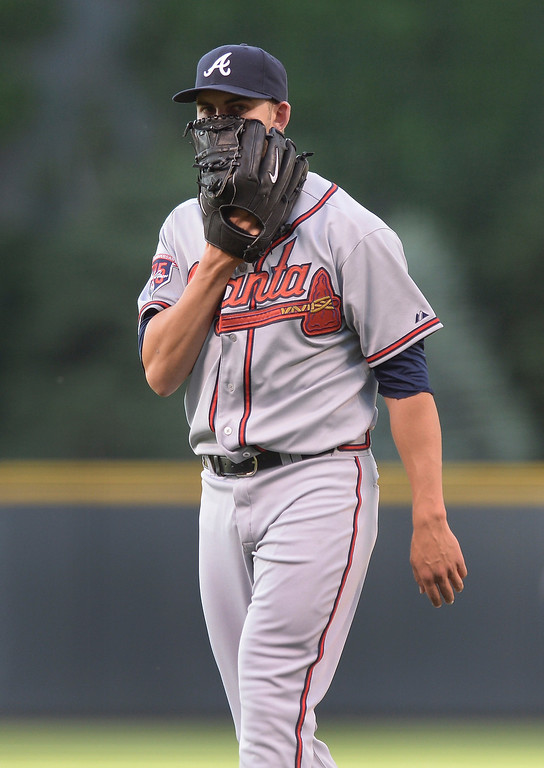 . Atlanta starting pitcher Mike Minor covered his mouth with his glove as he walked off the mound after the first inning. The Colorado Rockies hosted the Atlanta Braves Tuesday night, June 10, 2014. (Photo by Karl Gehring/The Denver Post)