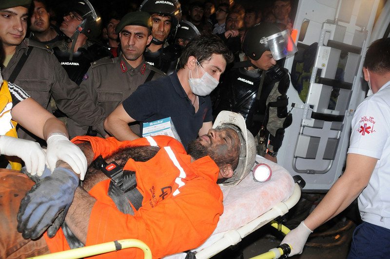 . Medics place a rescued miner into an ambulance after an explosion and fire at a coal mine killed at least 17 miners and left up to 300 workers trapped underground, in Soma, in western Turkey, Tuesday, May 13, 2014, a Turkish official said. (AP Photo/Depo Photos)