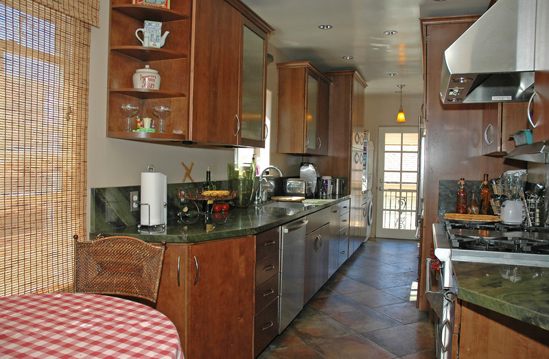 The remodeled kitchen is equipped with a Wolf gas stove and Wolf Hood.