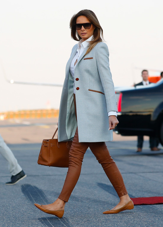 . First lady Melania Trump walks across the tarmac upon her arrival at the airport in Helsinki, Finland, Sunday, July 15, 2018 on the eve of President Trump\'s meeting with Russian President Vladimir Putin. (AP Photo/Pablo Martinez Monsivais)