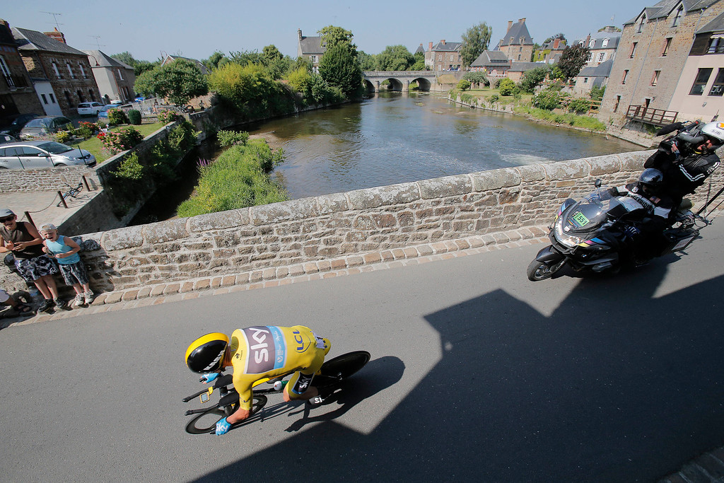 . Christopher Froome of Britain, wearing the overall leader\'s yellow jersey, passes through Ducey during the eleventh stage of the Tour de France cycling race, an individual time trial over 33 kilometers (20.6 miles) with start in in Avranches and finish in Mont-Saint-Michel, western France, Wednesday July 10 2013. (AP Photo/Christophe Ena)
