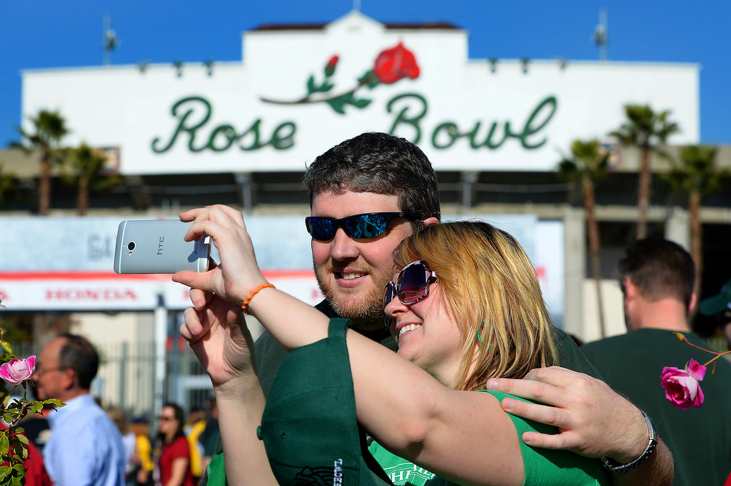 . Michigan State fans Rich LaPratt and Emily Stuart take a picture in front of the Rose Bowl, Wednesday, January 1, 2014. (Photo by Michael Owen Baker/L.A. Daily News)