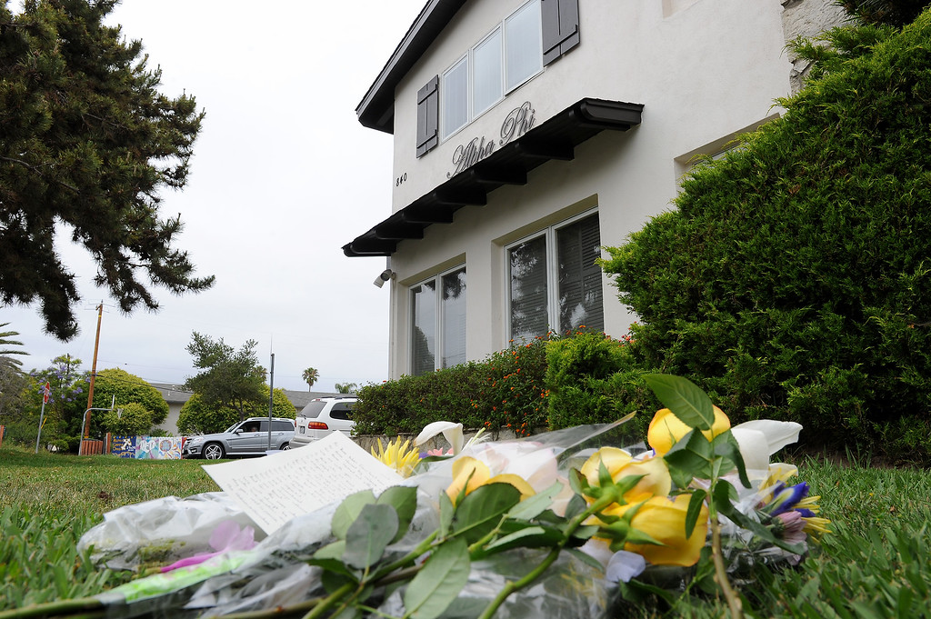 . Flowers lay on the grass in front of the Alpha Phi sorority house in Isla Vista, Saturday, May 24, 2014, which was one of the scenes of Friday night\'s shootings. (Photo by Michael Owen Baker/Los Angeles Daily News)