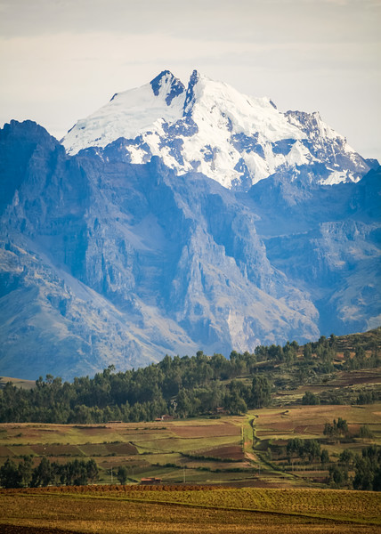 View of field with snow mountain in background - Peru